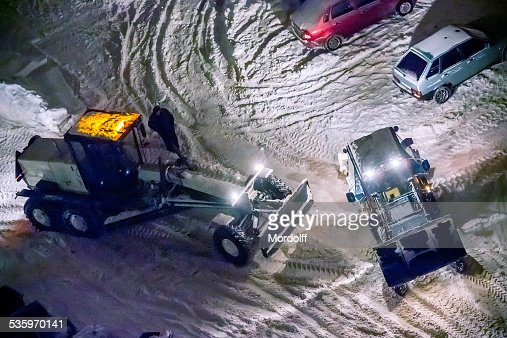 Snow cleaning town streets : Stock Photo