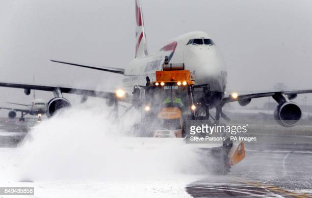 Snow clearing equipment is used at Heathrow Airport to clear road and taxiways as the worldOtildes busiest tworunway airport has defended itself...