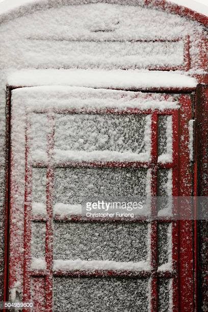 Snow clings to a phonebox in the Peak District near Buxton on January 14 2016 in Buxton England Overnight snowfall on the high ground of the Peak...
