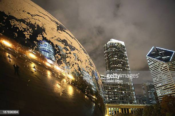 Snow collects on Anish Kapoor's Cloud Gate in Milennium Park on November 11 2013 in Chicago Illinois The snowfall was the first of the season for the...