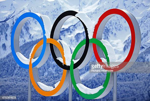 Snow collects on the Olympic Rings during day 12 of the 2014 Sochi Winter Olympics at Laura Crosscountry Ski Biathlon Center on February 19 2014 in...