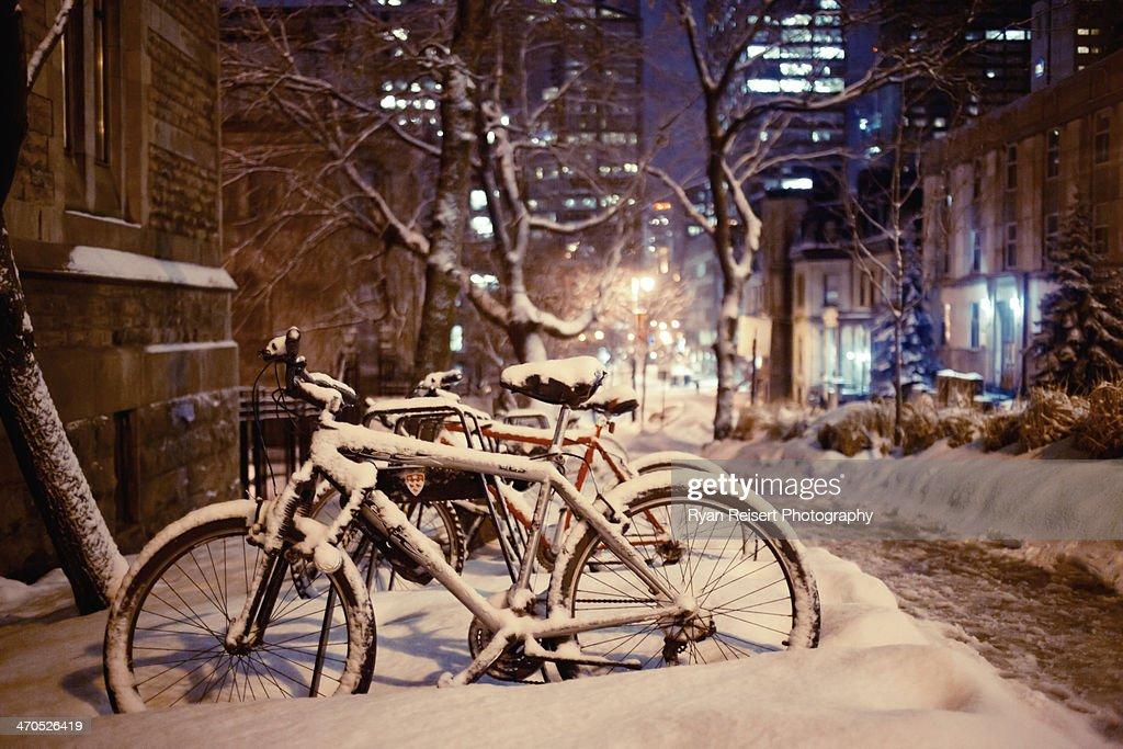 Snow Covered Bike at Night : Stock Photo