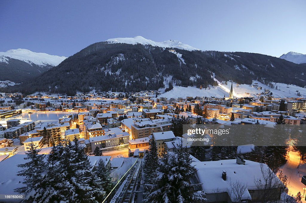 Snow covered buildings are seen at dusk from the Schatzalp area above the town of Davos, Switzerland, on Friday, Jan. 18, 2013. Next week the business elite gathers in the Swiss Alps for the 43rd annual meeting of the World Economic Forum in Davos, the five day event runs from Jan. 23-27. Photographer: Chris Ratcliffe/Bloomberg via Getty Images