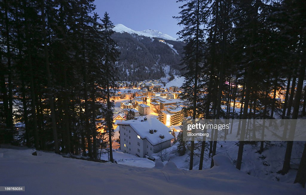 Snow covered buildings are seen at dusk in the town of Davos, Switzerland, on Friday, Jan. 18, 2013. Next week the business elite gathers in the Swiss Alps for the 43rd annual meeting of the World Economic Forum in Davos, the five day event runs from Jan. 23-27. Photographer: Chris Ratcliffe/Bloomberg via Getty Images