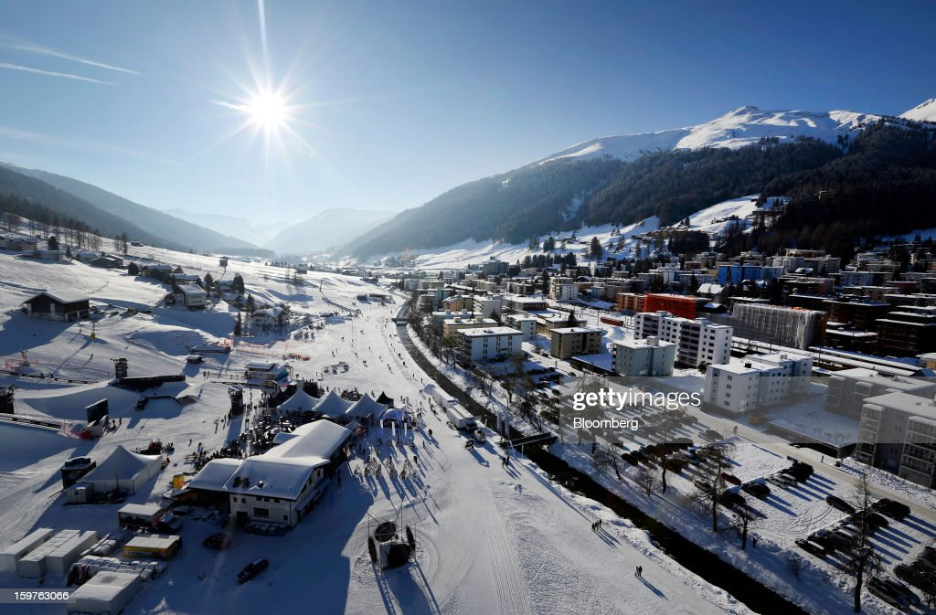 Snow covered buildings are viewed from the Jakobshorn cable car above the town of Davos, Switzerland, on Friday, Jan. 18, 2013. Next week the business elite gathers in the Swiss Alps for the 43rd annual meeting of the World Economic Forum in Davos, the five day event runs from Jan. 23-27. Photographer: Chris Ratcliffe/Bloomberg via Getty Images