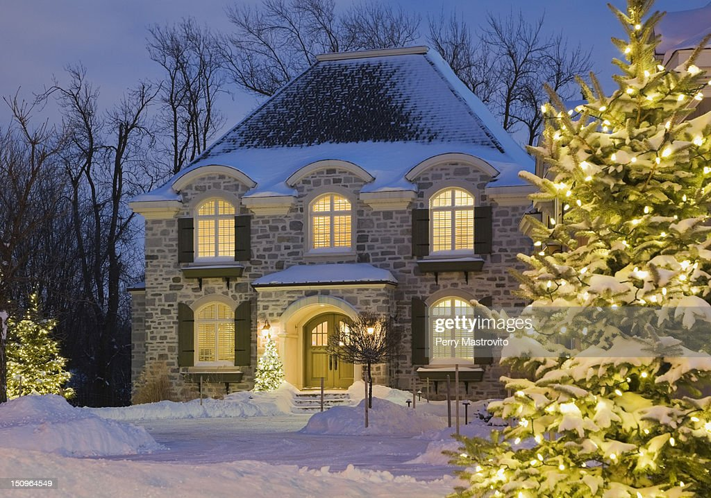 A Small, Wooden, Snow-covered Cottage In Winter Stock Photo ...