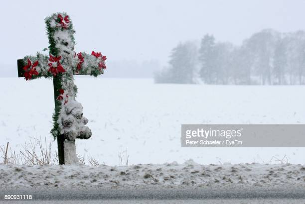 Snow Covered Cross On Field