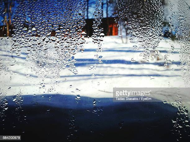 Snow Covered Field Seen Through Wet Glass