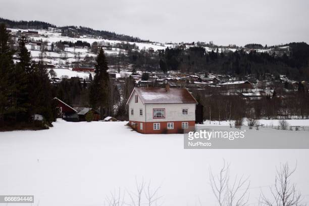 Snow covered houses and terrain along the OsloBergen train route on March 04 2017