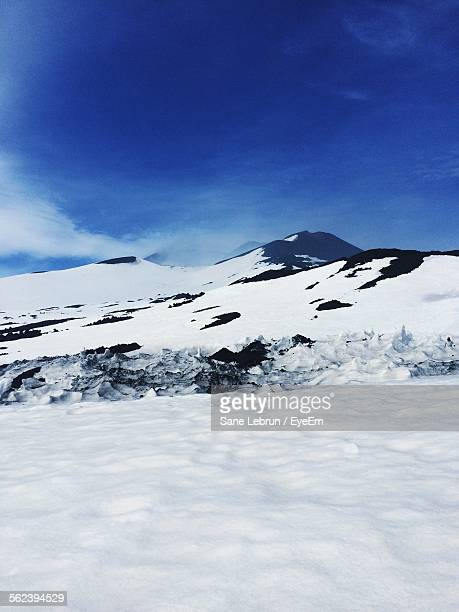 Snow Covered Mountain Against Cloudy Sky
