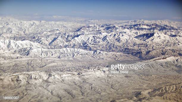 Snow covered mountain range view from air.