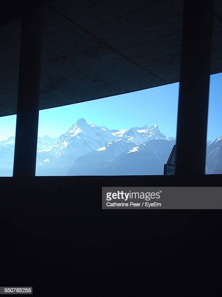 Snow Covered Mountain Viewed Through Overhead Cable Car
