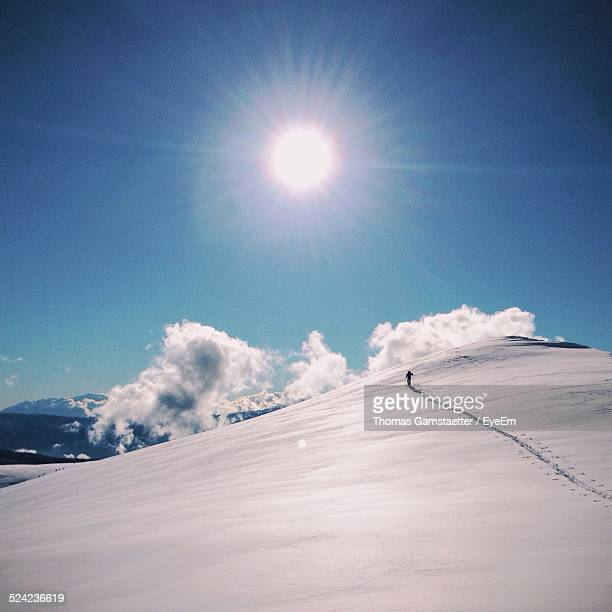Snow Covered Mountains Against Sky On Sunny Day