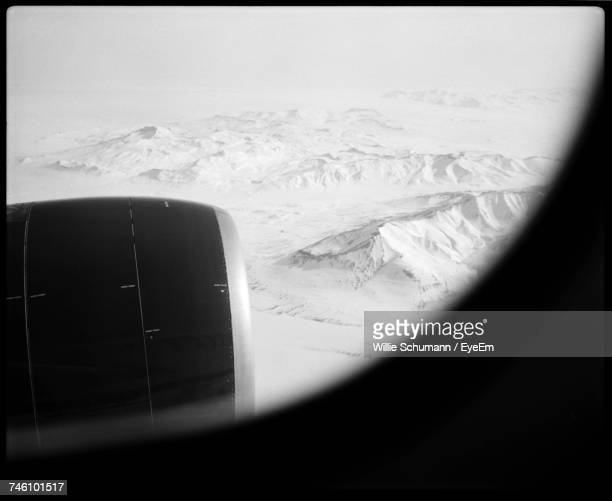 Snow Covered Mountains Seen Through Airplane Window