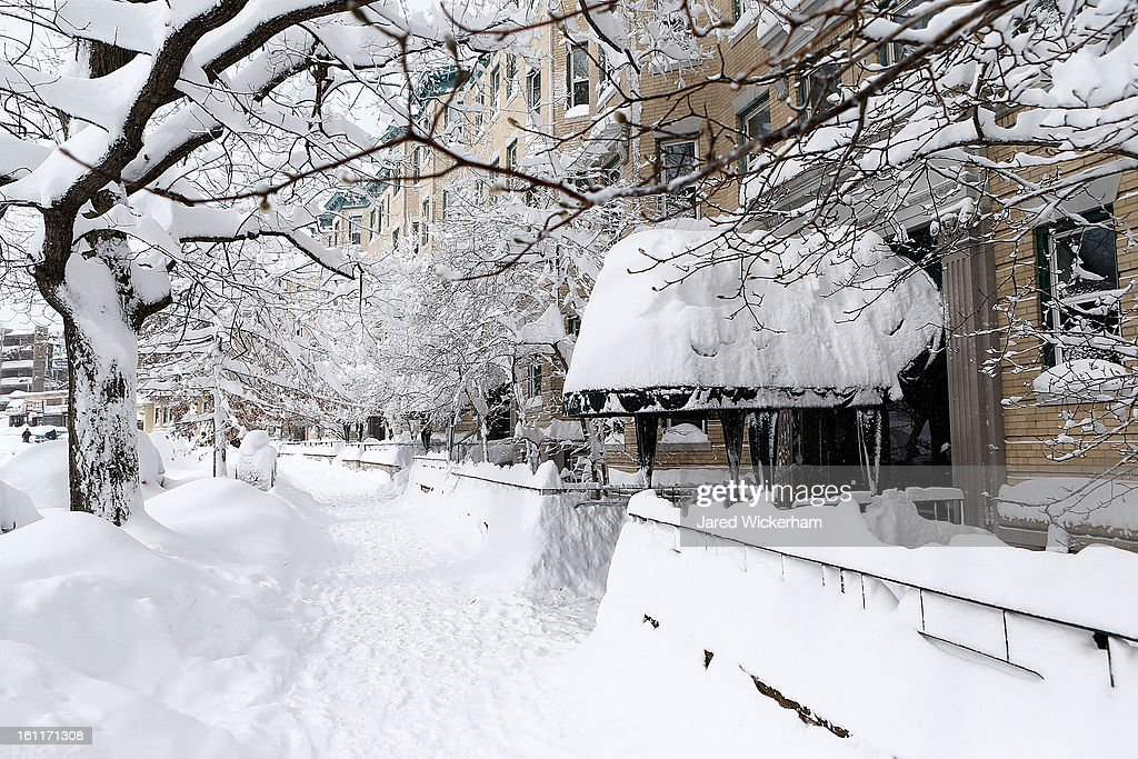 A snow covered sidewalk on Commonwealth Avenue is shown on February 9, 2013 in Boston, Massachusetts. The powerful storm has knocked out power to 650,000 and dumped more than two feet of snow in parts of New England.