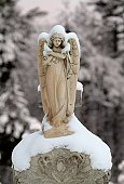 Snow covered stone angel.