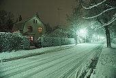 Snow covered street, night