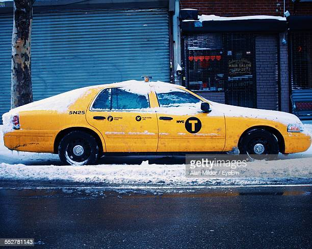 Snow Covered Taxi On City Street