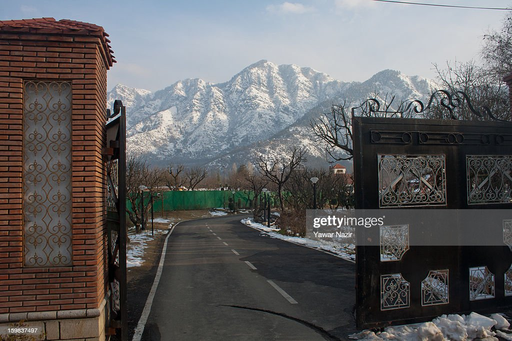 Snow covered Zabarwan are from the banks of Dal lake on January 21, 2012 in Srinagar, the summer capital of Indian Administered Kashmir, India. Weather conditions have improved in Kashmir after a two-day spell of heavy snowfall and rain that had distrupted road and air traffic, cutting off the Valley from the rest of the country.
