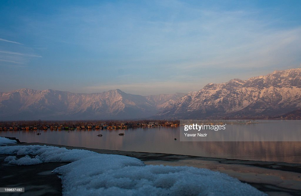 Snow covered Zabarwan mountains are reflected on the waters of Dal lake on January 21, 2012 in Srinagar, the summer capital of Indian Administered Kashmir, India. Weather conditions have improved in Kashmir after a two-day spell of heavy snowfall and rain that had distrupted road and air traffic, cutting off the Valley from the rest of the country.