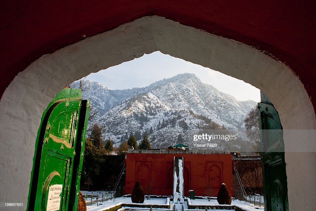 Snow covered Zabarwan mountains are seen from a garden on January 21, 2012 in Srinagar, the summer capital of Indian Administered Kashmir, India. Weather conditions have improved in Kashmir after a two-day spell of heavy snowfall and rain that had distrupted road and air traffic, cutting off the Valley from the rest of the country.