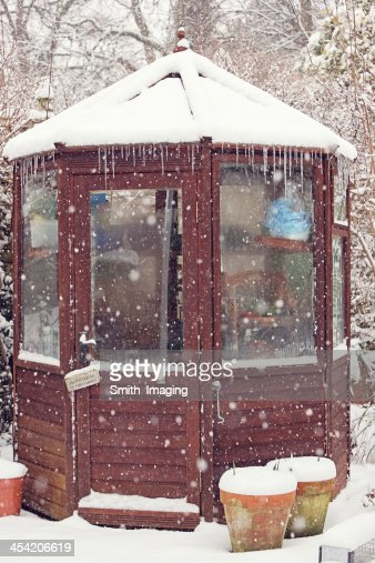 Snow covering the garden shed : Stock Photo
