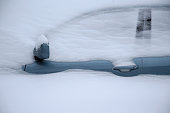 Snow covers a car on January 27 2015 in Cambridge Massachusetts Boston and much of the Northeast is being hit with heavy snow from Winter Storm Juno