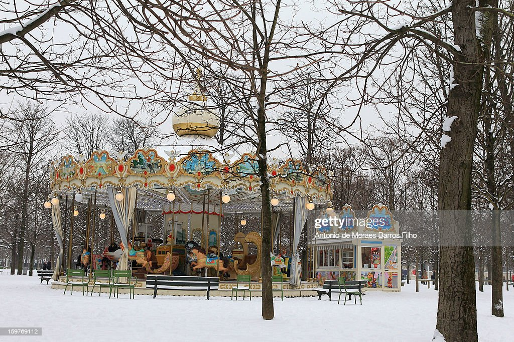 Snow covers a carousel on January 20, 2013 in Paris, France. Heavy snowfall fell throughout Europe and the UK causing travel havoc and white layers of pretty scenery.