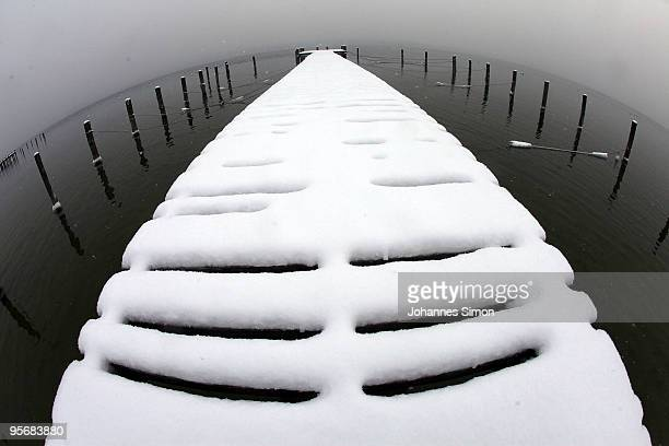 Snow covers a dock at Ammersee lake on January 11 2010 in Schondorf am Ammersee Germany Depression 'Daisy' brought havoc in Germany as treacherous...