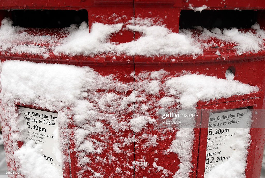 Snow covers a red post box on January 21, 2013 in Bath, England. As the UK's cold snap continues, parts of the country including the South West and Wales were bracing themselves for even more snow, forecast to arrive tonight and tomorrow.