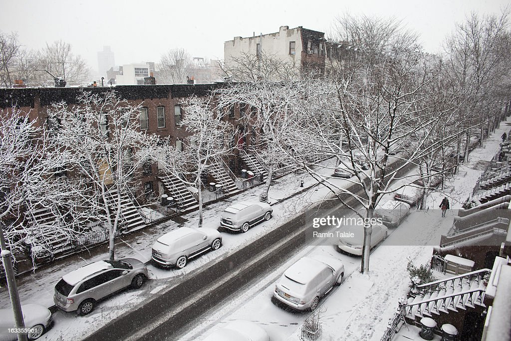Snow covers a street in the Prospect Heights section on March 8, 2012 in Brooklyn borough of New York City. The storm part of the same system that pummeled the Midwest is expected to dump one to two inches of snow in the New York Metro area.