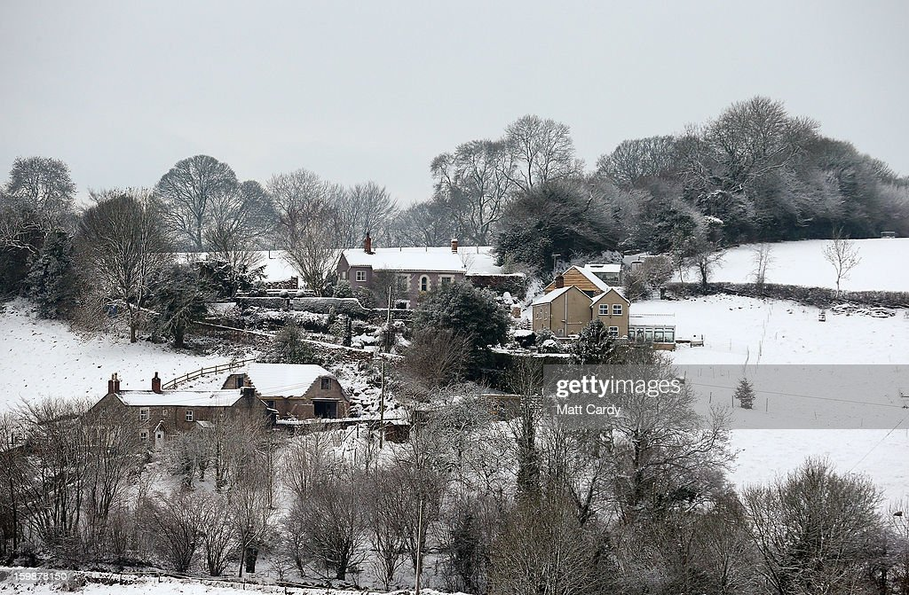Snow covers fields near Holcombe on January 22, 2013 in Somerset, England. Snow and ice is continuing to cause disruption to some parts of the UK with more snow forecast for the South West tonight.