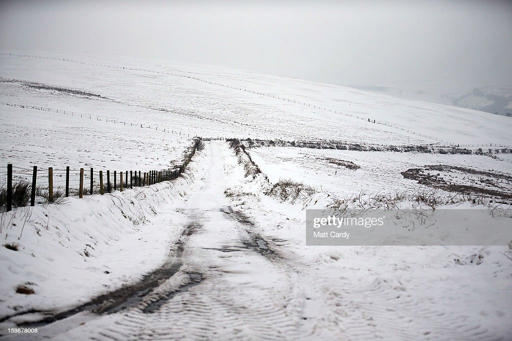 Snow covers fields near to Simonsbath on January 22, 2013 on Exmoor, England. Snow and ice is continuing to cause disruption to some parts of the UK with more snow forecast for the South West tonight.