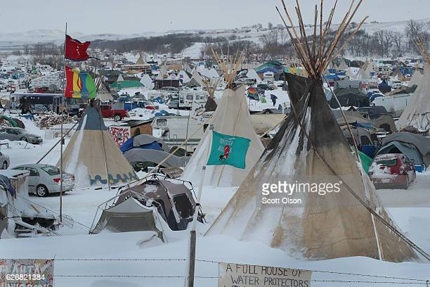 Snow covers Oceti Sakowin Camp near the Standing Rock Sioux Reservation on November 30 2016 outside Cannon Ball North Dakota Native Americans and...