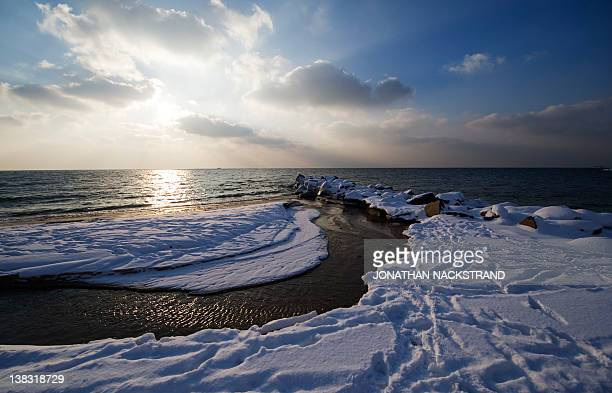Snow covers on February 5 2012 the shore near the city of Ronne on the Danish island of Bornholm in the Baltic Sea The deadly cold snap that has...