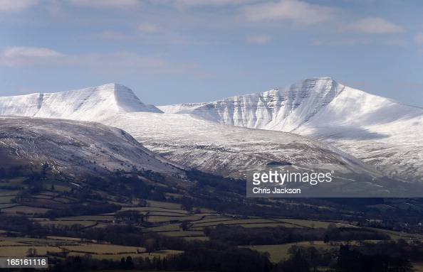 Snow covers PenYFan on Easter Day at Gwndwnwal Farm on March 31 2013 in Brecon Wales Dai Brute runs Gwndwnwal Farm in LlanTalyllyn Brecon with his...