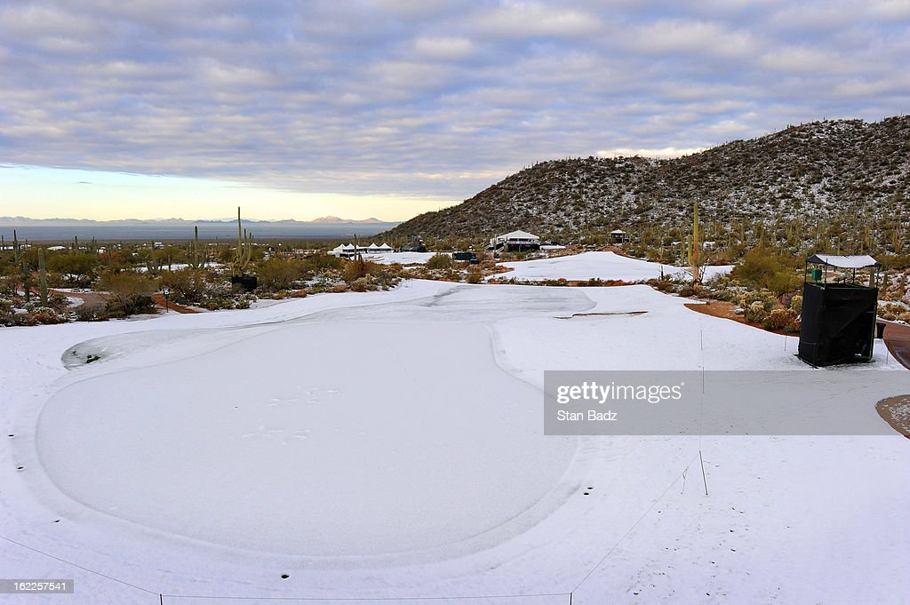 Snow covers the 15th hole before the restart of the first round of the World Golf Championships-Accenture Match Play Championship at The Golf Club at Dove Mountain on February 21, 2013 in Marana, Arizona.