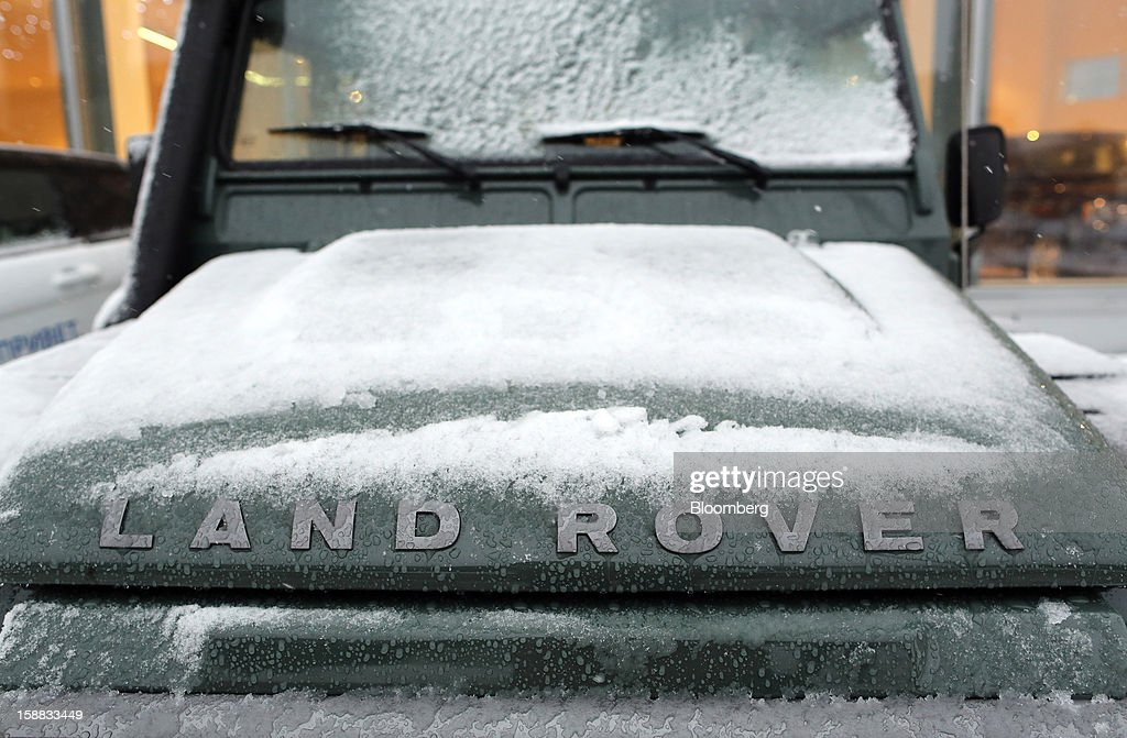 Snow covers the bonnet of a Land Rover Defender automobile used for customer test drives outside a Jaguar Land Rover auto dealership in Moscow, Russia, on Thursday, Dec. 27, 2012. Tata Motors Ltd.'s Jaguar Land Rover luxury unit signed a letter of intent with Saudi Arabia's government to study the feasibility of setting up a factory to build its models locally. Photographer: Andrey Rudakov/Bloomberg via Getty Images