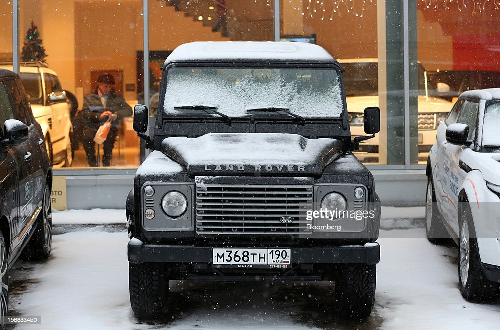 Snow covers the bonnet of a Land Rover Defender customer test automobile outside a Jaguar Land Rover auto dealership in Moscow, Russia, on Thursday, Dec. 27, 2012. Tata Motors Ltd.'s Jaguar Land Rover luxury unit signed a letter of intent with Saudi Arabia's government to study the feasibility of setting up a factory to build its models locally. Photographer: Andrey Rudakov/Bloomberg via Getty Images