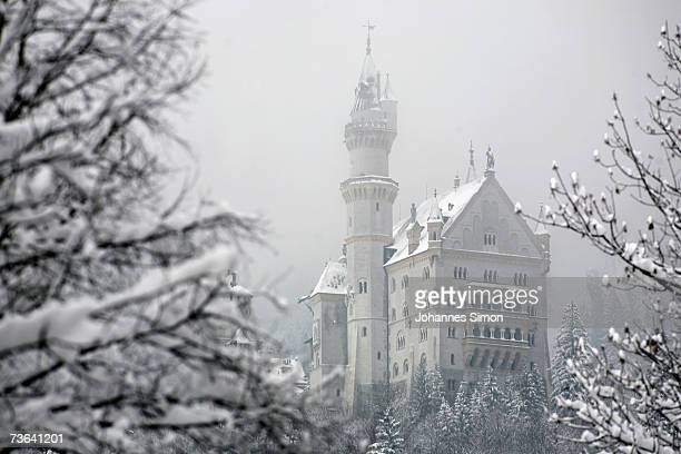 Snow covers the 'fairy tale' Neuschwanstein Castle on March 20 2007 near Fussen Germany Following a spell of warm weather temperatures dropped...