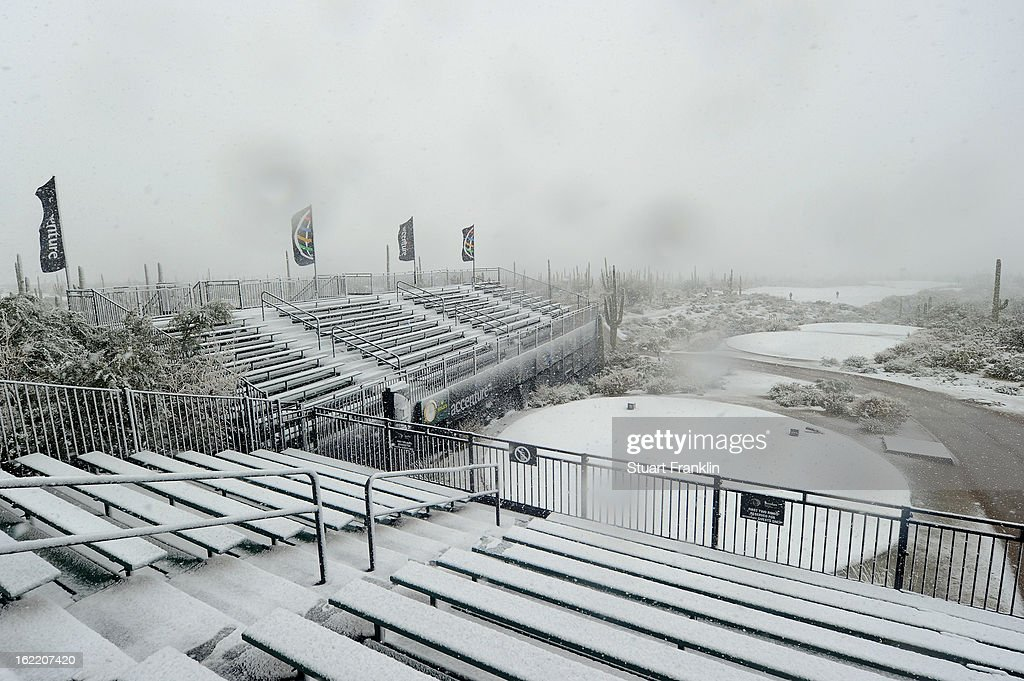 Snow covers the first hole tee and the grandstands as play was suspended during the first round of the World Golf Championships - Accenture Match Play at the Golf Club at Dove Mountain on February 20, 2013 in Marana, Arizona.