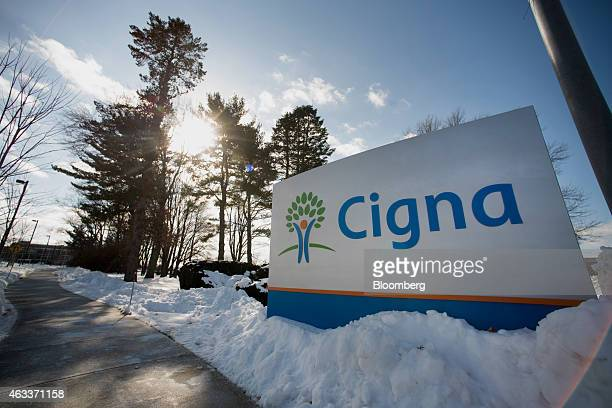 Snow covers the ground around Cigna Corp signage displayed at the company's headquarters in Bloomfield Connecticut US on Friday Feb 6 2015...