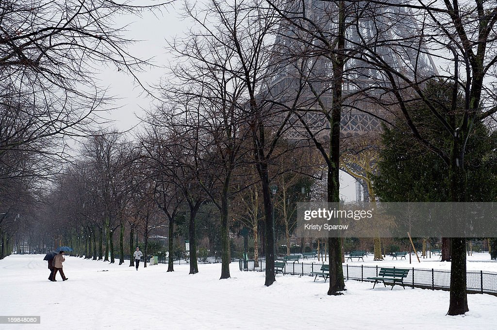 Snow covers the ground around the Eiffel Tower on January 21, 2013 in Paris, France. Heavy snowfall fell throughout Europe and the UK causing travel havoc and white layers of pretty scenery.