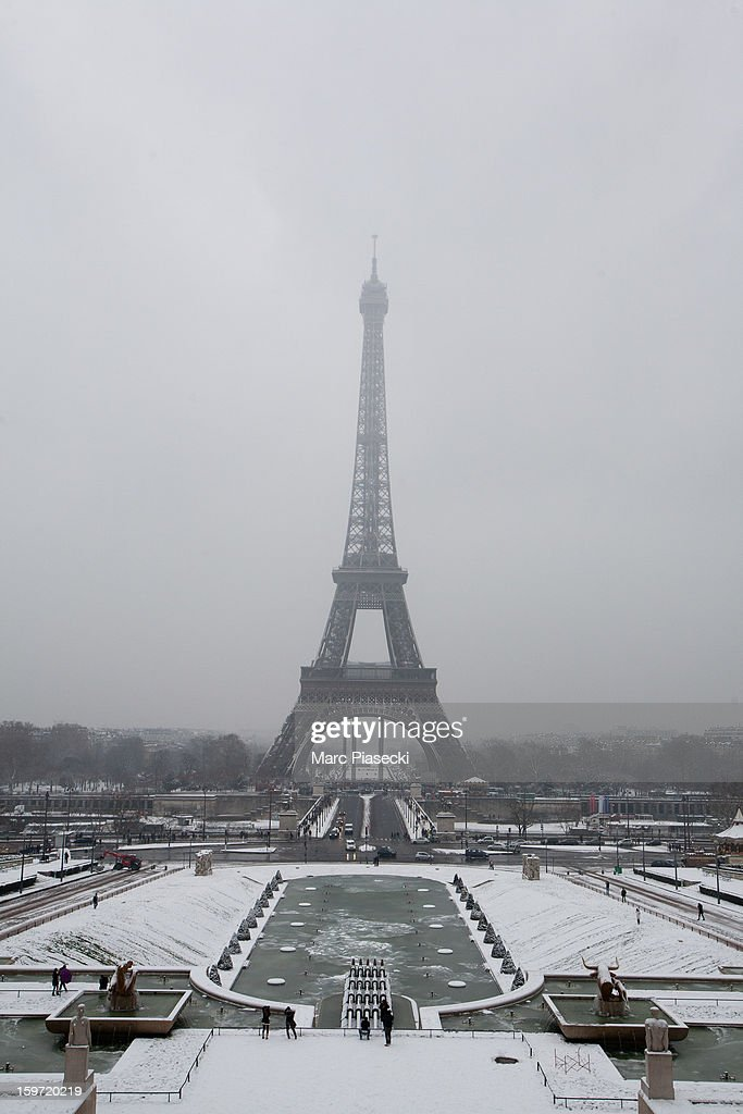 Snow covers the ground near the Eiffel Tower on January 19, 2013 in Paris, France. Heavy snowfall fell throughout Europe and the UK causing travel havoc and white layers of pretty scenery.