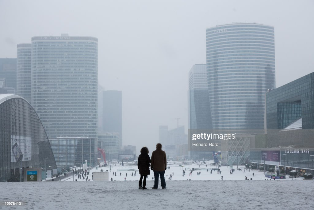 Snow covers the ground of La Defense on January 19, 2013, in Paris, France. Heavy snowfall fell throughout Europe and the UK causing travel havoc and white layers of pretty scenery.