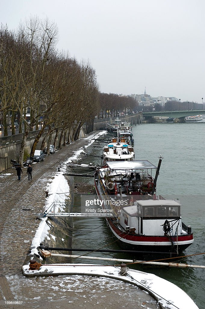 Snow covers the ground on January 21, 2013 in Paris, France. Heavy snowfall fell throughout Europe and the UK causing travel havoc and white layers of pretty scenery.