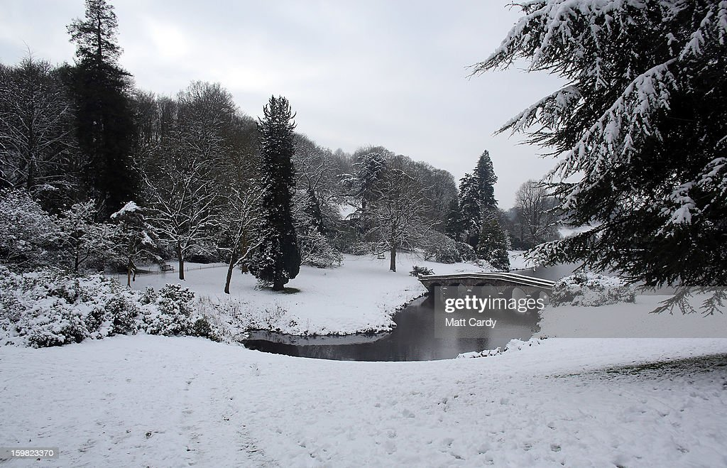Snow covers the grounds and the trees surrounding the Palladian bridge at the National Trust's Stourhead on January 21, 2013 in Wiltshire, England. As the UK's cold snap continues, parts of the country including the South West and Wales were bracing themselves for even more snow, forecast to arrive tonight and tomorrow.