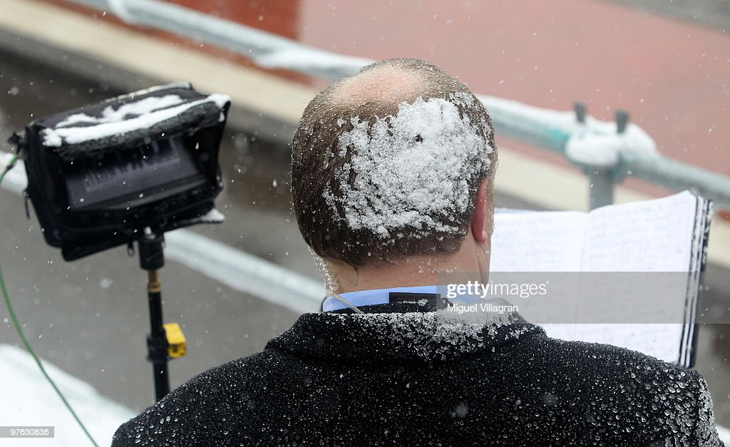 Snow covers the head of a journalist during the commemoration ceremony in front of the Albertville School on March 11, 2010 in Winnenden, Germany. Tim Kretschmer opened fire on teachers and pupils at his former school a year ago on March 11, 2009, killing 15 and leaving many more injured. Kretschmer fled the scene and shot himself dead after being cornered by police.