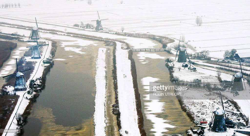 Snow covers the historic windmills at Kinderdijk, The Netherlands, on January 15, 2013. In 1997, the windmills were put on the UNESCO World Heritage List. UTRECHT netherlands out -