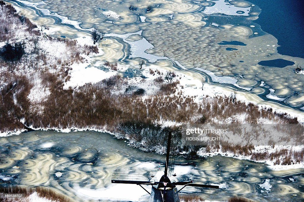 Snow covers the historic windmills at Kinderdijk, The Netherlands, on January 15, 2013. In 1997 the windmills were put on the UNESCO World Heritage List. UTRECHT netherlands out